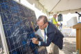 Jeff Ackermann, Colorado Energy Office director signs a solar panel at the 156 MW Comanche Solar gro